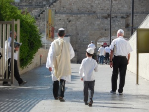 3 generations heading to pray